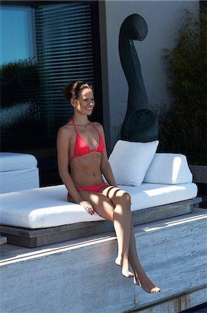 Beautiful lady in bright bikini sitting Stock Photo - Rights-Managed, Code: 847-03758041