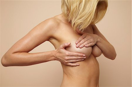Beautiful nude mature blonde woman holding her body Stock Photo - Rights-Managed, Code: 847-03862665