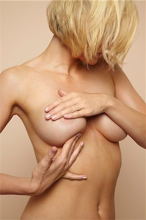 Beautiful nude mature blonde woman holding her body Stock Photo - Rights-Managed, Code: 847-03862666