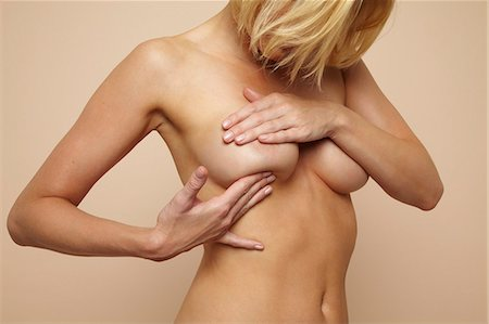 Beautiful nude mature blonde woman holding her body Stock Photo - Rights-Managed, Code: 847-03862667