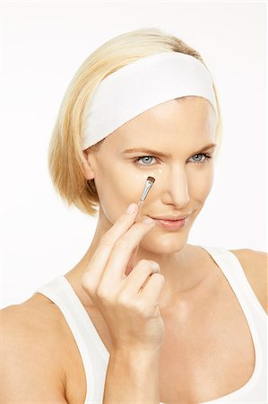 Beautiful mature blonde woman applying concealer Stock Photo - Rights-Managed, Code: 847-03862714