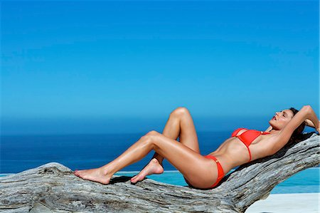 Beautiful brunette lying on the beach Stock Photo - Rights-Managed, Code: 847-03862865