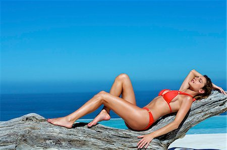 Beautiful brunette lying on the beach Stock Photo - Rights-Managed, Code: 847-03862866