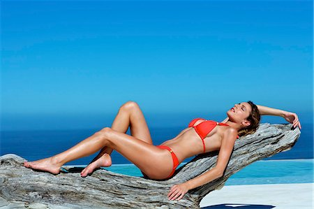 Beautiful brunette lying on the beach Stock Photo - Rights-Managed, Code: 847-03862868