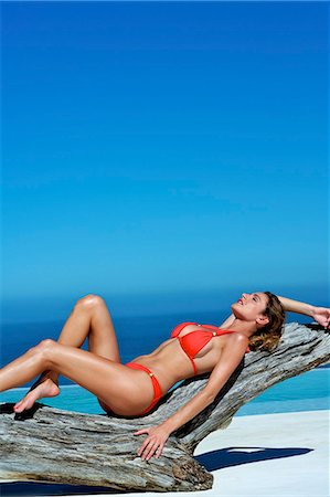 Beautiful brunette lying on the beach Stock Photo - Rights-Managed, Code: 847-03862870