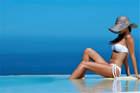 Beautiful brunette sitting by a pool Stock Photo - Rights-Managed, Code: 847-03862898