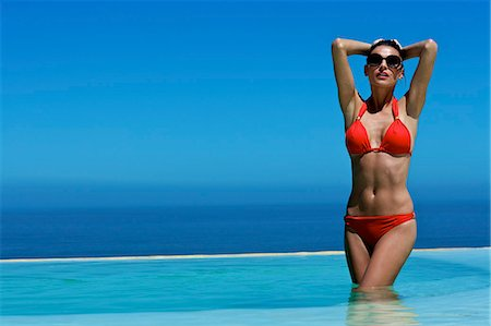 Beautiful brunette in swimming pool Stock Photo - Rights-Managed, Code: 847-03862924