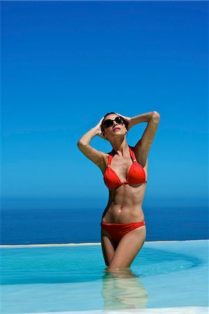 Beautiful brunette in swimming pool Stock Photo - Rights-Managed, Code: 847-03862923