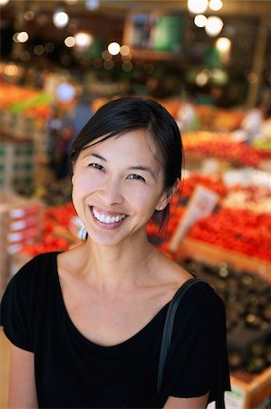 Portrait of woman smiling in market Stock Photo - Rights-Managed, Code: 849-05598977