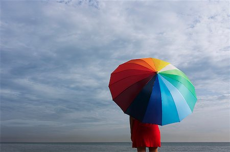 dependable - Legs of young woman underneath big umbrella Stock Photo - Rights-Managed, Code: 849-02864166
