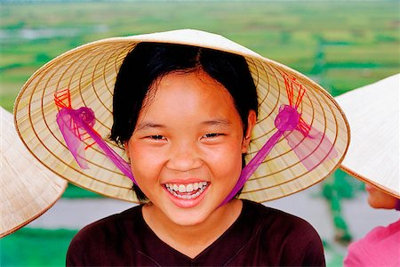 Vietnam, Perfume Pagoda, Hanoi, Young girl wearing hat Stock Photo - Rights-Managed, Code: 849-02864852