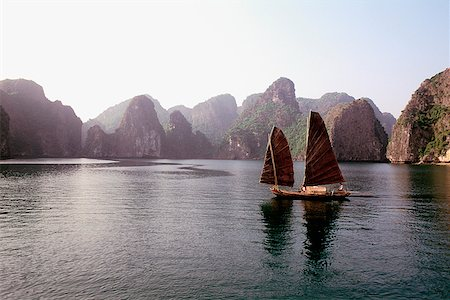 sports and sailing - Vietnam, Halong Bay, Fishing junk sailing amongst the islands Stock Photo - Rights-Managed, Code: 849-02866031