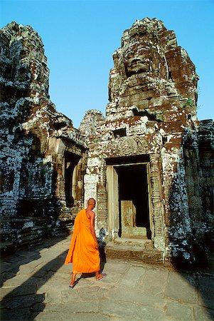 Cambodia, Angkor Thom, monk walking between face towers of the Bayon Stock Photo - Rights-Managed, Code: 849-02866056