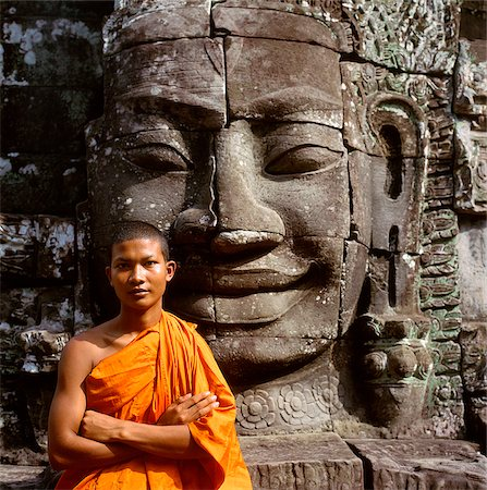 Cambodia, Ankor Thom, portrait of monk in front of the face of Avalokitesvara Stock Photo - Rights-Managed, Code: 849-02866101