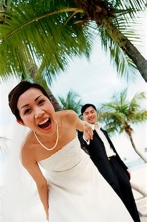 Groom holding bride's hand on beach ( high grain) Stock Photo - Rights-Managed, Code: 849-02866135