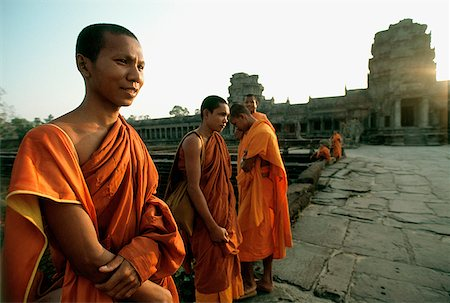 Cambodia, Angkor Wat, Young monks on stone path to temple Stock Photo - Rights-Managed, Code: 849-02866256