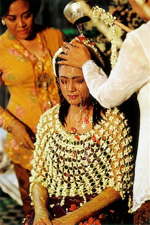Indonesia, A bride undergoing a purification ritual of Javanese origin on the first day of a two-day wedding celebration. Stock Photo - Rights-Managed, Code: 849-02866788