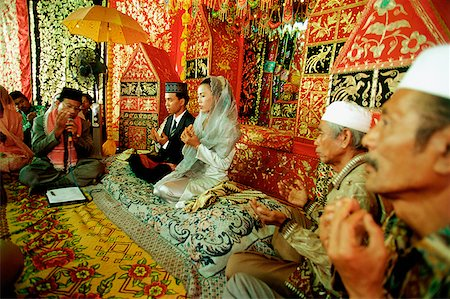 Indonesia, a Muslim cleric reading from the Koran to bind bride and groom in marriage. Stock Photo - Rights-Managed, Code: 849-02866783
