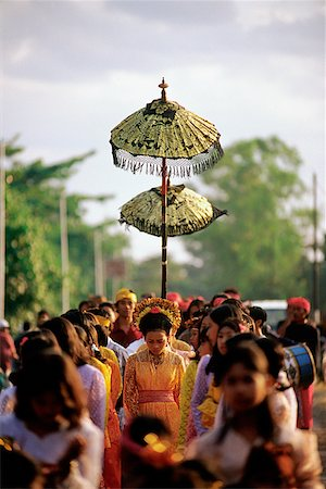 Indonesia, Lombok, a bride walking under a canopy and accompanied by female attendants, following musicians to the groom's home. Stock Photo - Rights-Managed, Code: 849-02866791