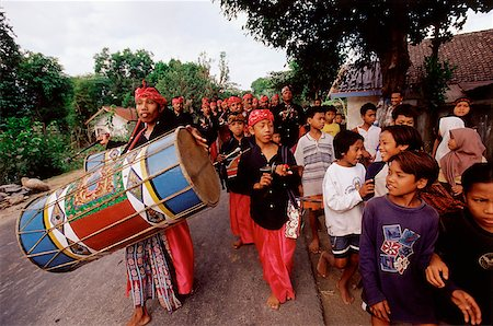 Indonesia, Lombok, Drummers leading a wedding procession past a crowd on the street. Stock Photo - Rights-Managed, Code: 849-02866810