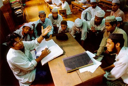 Myanmar (Burma), Yangon (Rangoon), Students and members of the Muslim community listening to a teacher. Stock Photo - Rights-Managed, Code: 849-02866922