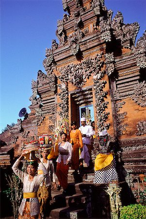 Indonesia, Bali, Hindu festival, People with offerings enter temple via candi bentar (split gates). Stock Photo - Rights-Managed, Code: 849-02867244