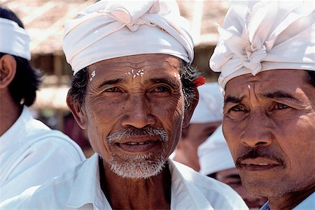 Indonesia, Bali, Hindu priests with rice markings on their foreheads at festival. Stock Photo - Rights-Managed, Code: 849-02867246