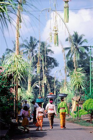 Indonesia, Bali, Village streets decorated with bamboo penjors at festival time (Galungan). Stock Photo - Rights-Managed, Code: 849-02867241
