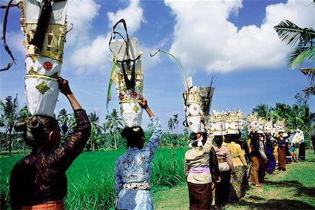 Indonesia, Bali, Women carrying offerings on their heads going to temple festival. Stock Photo - Rights-Managed, Code: 849-02867243