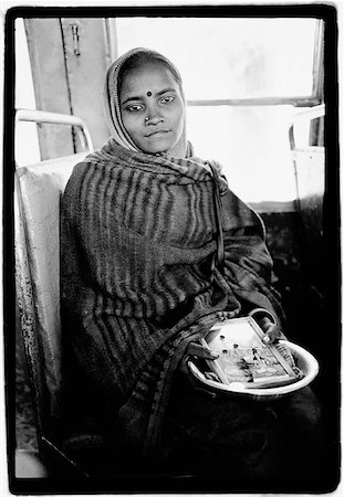 India, Dharamsala, Indian girl on bus holding Hindu icons. Stock Photo - Rights-Managed, Code: 849-02867589