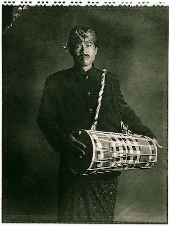 Indonesia, Bali, Amlapura, Gamelan player holding drum. Stock Photo - Rights-Managed, Code: 849-02867606