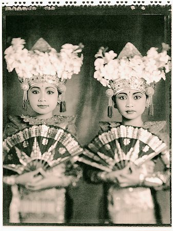 Indonesia, Bali, Amlapura, Two Legong dancers in full costumes holding fans. Stock Photo - Rights-Managed, Code: 849-02867600
