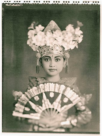 Indonesia, Bali, Amlapura, Legong dancer in full costume holding fan. Stock Photo - Rights-Managed, Code: 849-02867601