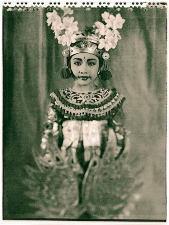 Indonesia, Bali, Amlapura, Condong dancer in full costume holding golden wings. Stock Photo - Rights-Managed, Code: 849-02867602