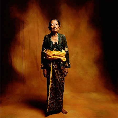 Indonesia, Bali, Ubud, Mature Balinese woman in ceremonial dress. Stock Photo - Rights-Managed, Code: 849-02867629