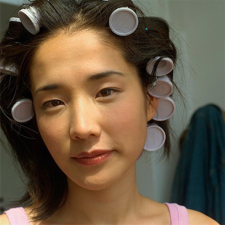 Young woman with curlers in hair, portrait Stock Photo - Rights-Managed, Code: 849-02868413