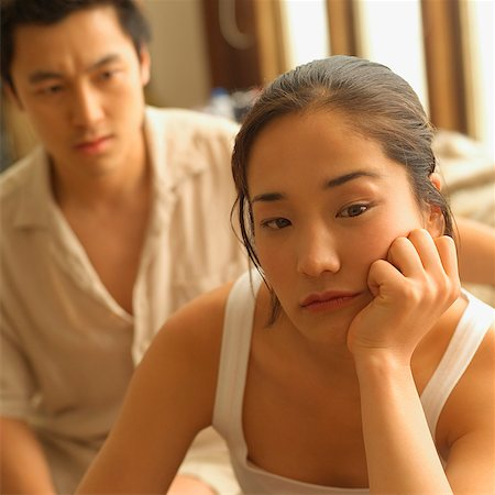 sad lovers break up - Couple sitting apart, woman with hand on chin Stock Photo - Rights-Managed, Code: 849-02868426