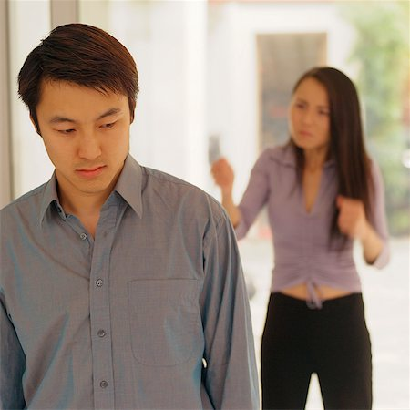 sad lovers break up - Man looking down, woman behind him gesturing Stock Photo - Rights-Managed, Code: 849-02868493