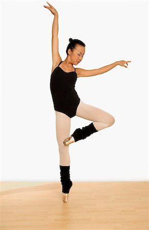 Young woman balancing on toes. Stock Photo - Rights-Managed, Code: 849-02868503