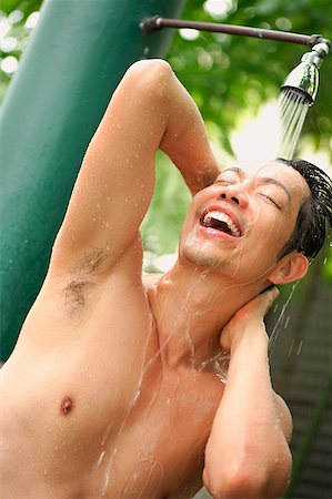 Man taking a shower outdoors Stock Photo - Rights-Managed, Code: 849-02861221