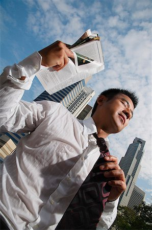 sweaty businessman - Businessman fanning himself with magazine Stock Photo - Rights-Managed, Code: 849-02861482