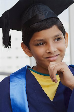 preteen  smile  one  alone - young boy graduate with hand on chin Stock Photo - Rights-Managed, Code: 849-02862476