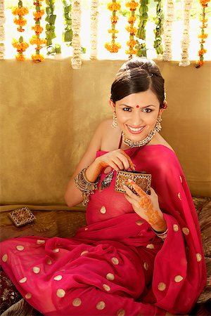 young woman wearing sari and bindi Stock Photo - Rights-Managed, Code: 849-02863280