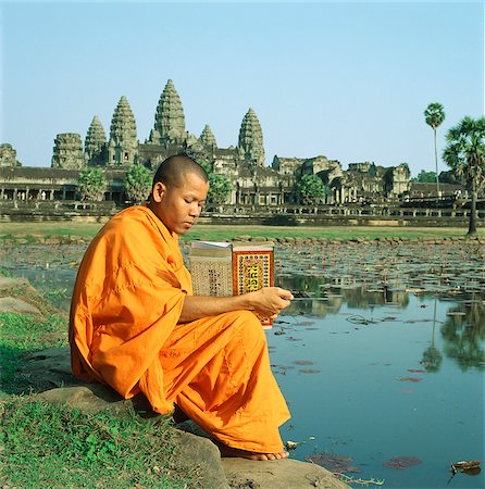 Cambodia, Sien Reap, Province, Angkor Wat, Buddhist monk reading Buddhist manuscript in front of temple Stock Photo - Rights-Managed, Code: 849-02874985