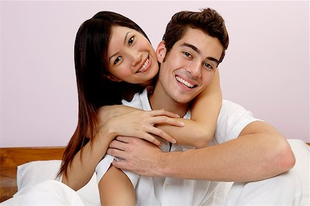 Couple embracing, looking at camera, portrait Stock Photo - Rights-Managed, Code: 849-02876331