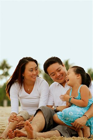 Family with one child, daughter laughing Stock Photo - Rights-Managed, Code: 849-02871073