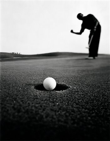 silhouette black and white - Asian golfer putting ball in hole Stock Photo - Rights-Managed, Code: 849-02872876