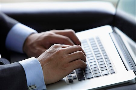 Close up of man using lap top computer Stock Photo - Rights-Managed, Code: 849-03457280