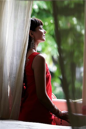 singapore traditional costume lady - Indian woman looking out window Stock Photo - Rights-Managed, Code: 849-03645472