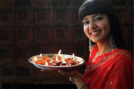 singapore traditional costume lady - Indian woman holding tray of lit oil lamps Stock Photo - Rights-Managed, Code: 849-03645480